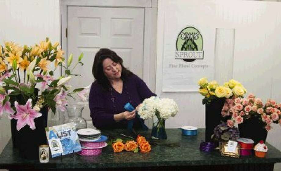 Ann Engelbrecht, owner of Sprout Fine Floral Concepts, prepares a flower arrangement for one of her clients.