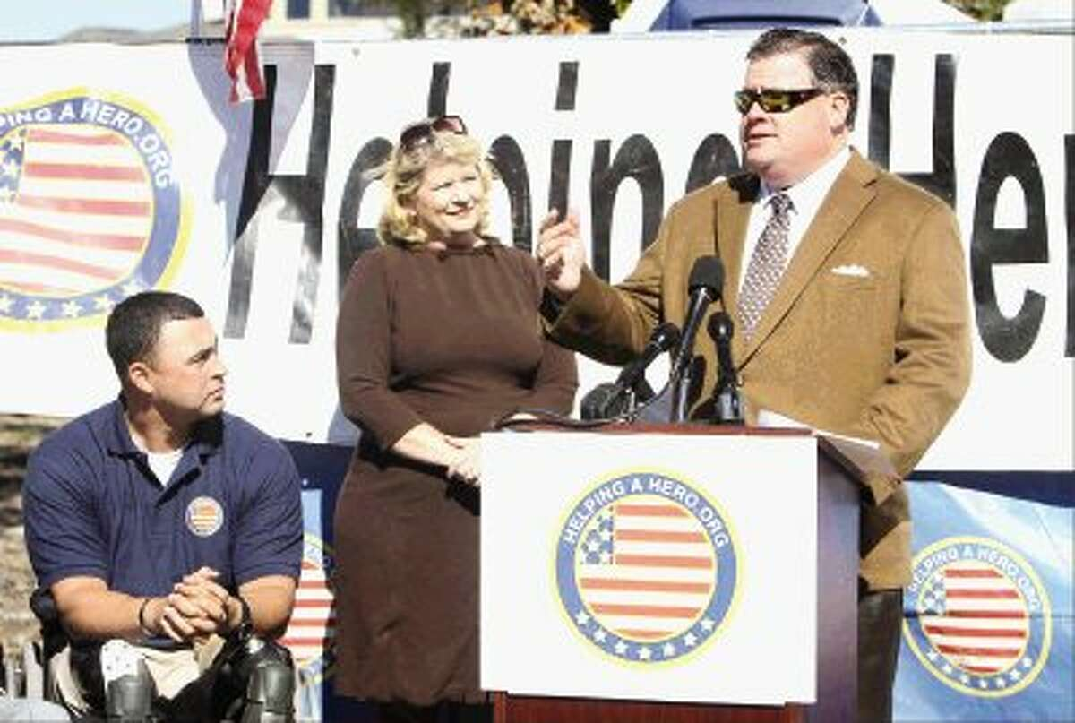 """Texas Sen. Tommy Williams, R-The Woodlands, addresses the crowd during a groundbreaking ceremony of U.S. Army Maj. Will Lyles's new home provided by """"Helping a Hero,"""" an organization that builds homes for wounded soldiers, in The Woodlands Wednesday. Go to HCNPics.com to view more photos from the event."""