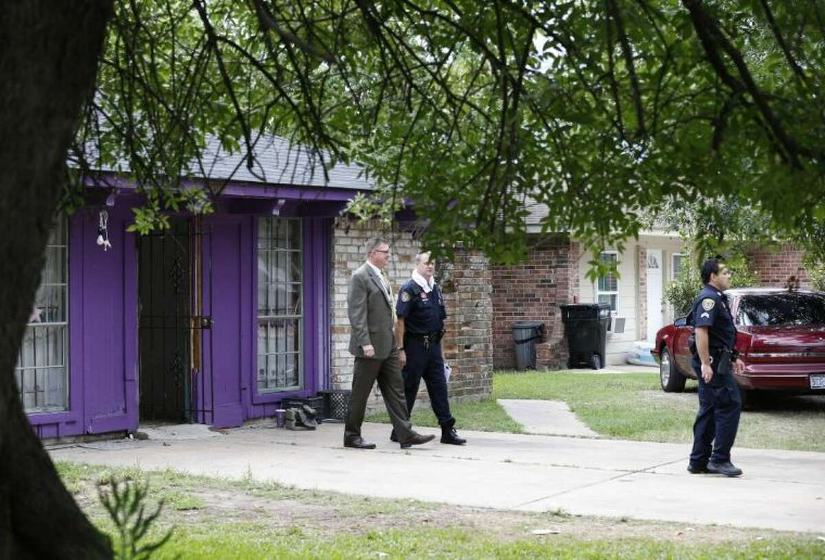 Authorities investigate a home Friday in Houston where police say four homeless men were found in deplorable conditions. Officers who responded to a call expressing concern said they found three men locked in a garage and a fourth in the home who were malnourished and may have been being held so a captor could cash checks the men were receiving. One person was taken into custody.