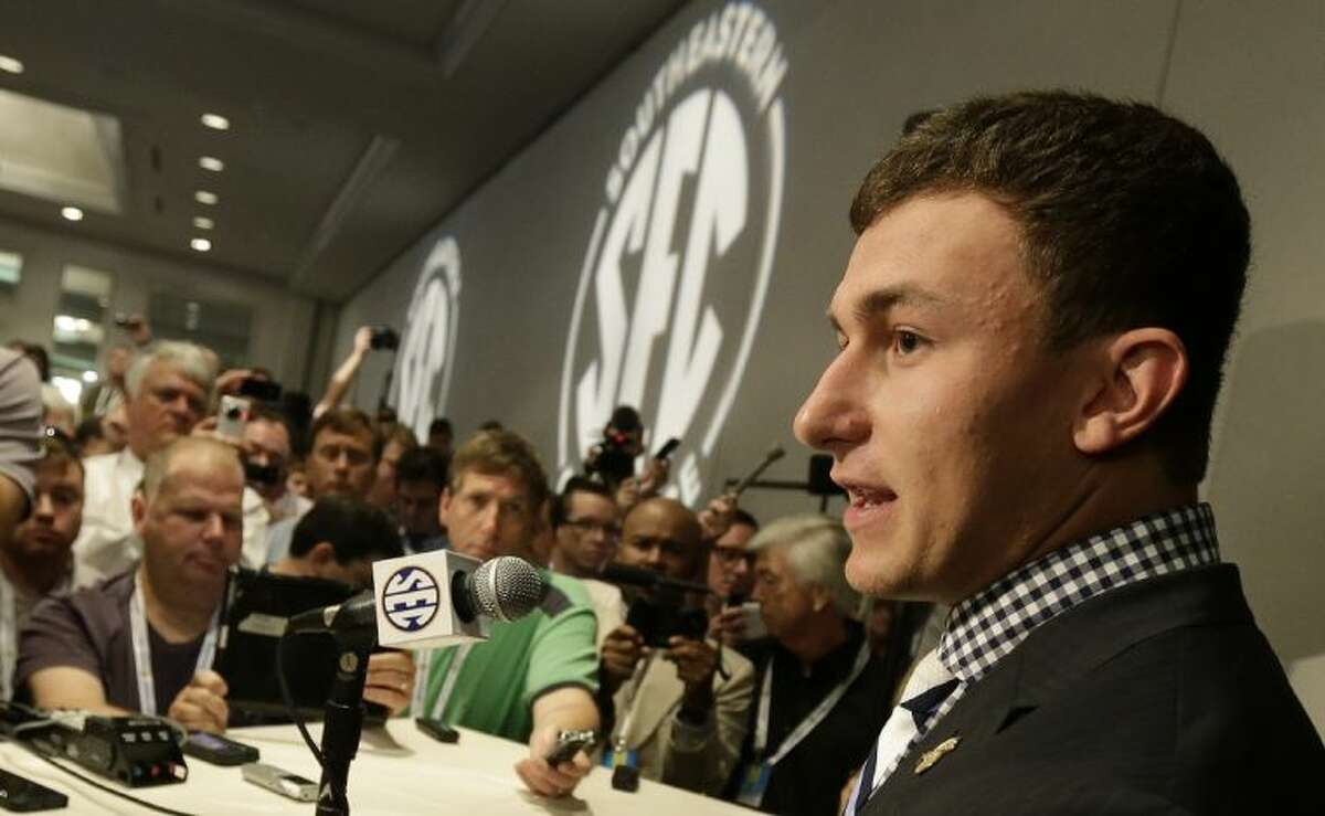 Texas A&M quarterback Johnny Manziel talks with reporters during the Southeastern Conference football media days on Wednesday in Hoover, Ala.