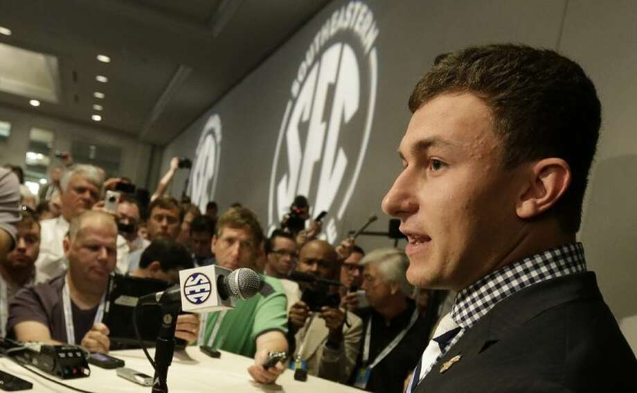 Texas A&M quarterback Johnny Manziel talks with reporters during the Southeastern Conference football media days on Wednesday in Hoover, Ala. Photo: Dave Martin