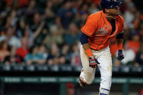 Houston Astros Yulieski Gurriel (10) runs to first base after hitting an RBI single during the seventh inning of an MLB game at Minute Maid Park, Saturday, Sept. 24, 2016 in Houston.