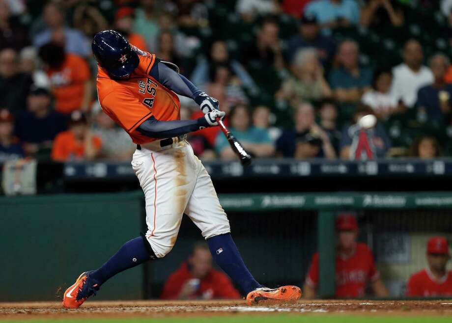 Houston Astros George Springer (4) hits an RBI triple during the seventh inning of an MLB game at Minute Maid Park, Saturday, Sept. 24, 2016 in Houston. Photo: Karen Warren, Houston Chronicle / 2016 Houston Chronicle