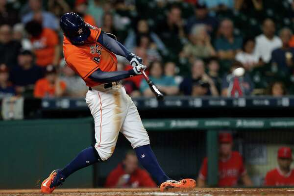 Houston Astros George Springer (4) hits an RBI triple during the seventh inning of an MLB game at Minute Maid Park, Saturday, Sept. 24, 2016 in Houston.