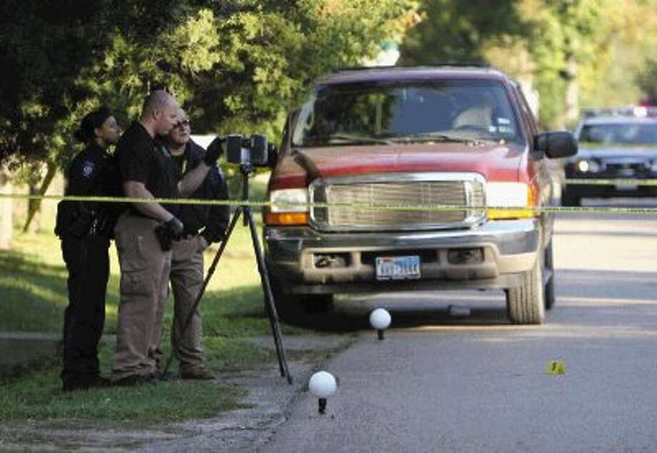 Conroe police work the scene of a shooting near Jewel Street and Mill Avenue Tuesday morning. / Jason Fochtman