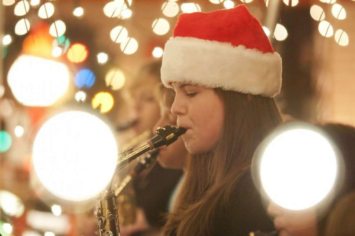 """Elaine Schneider, 15, a student at Oak Ridge High School, will perform on her saxophone for her third appearance at """"Bad Bob's Christmas Bash on the Lawn"""" Dec. 21 at 6 p.m. The public is invited to this free concert at 103 South Delmont, home of Bob and Barbara Price, in Conroe. Dozens of musicians of all ages have participated sine the event's inception in 2009. Attendees should provide their own lawn chairs, and may contribute non-perishable food for the county food bank. Schneider takes music lessons from Price."""