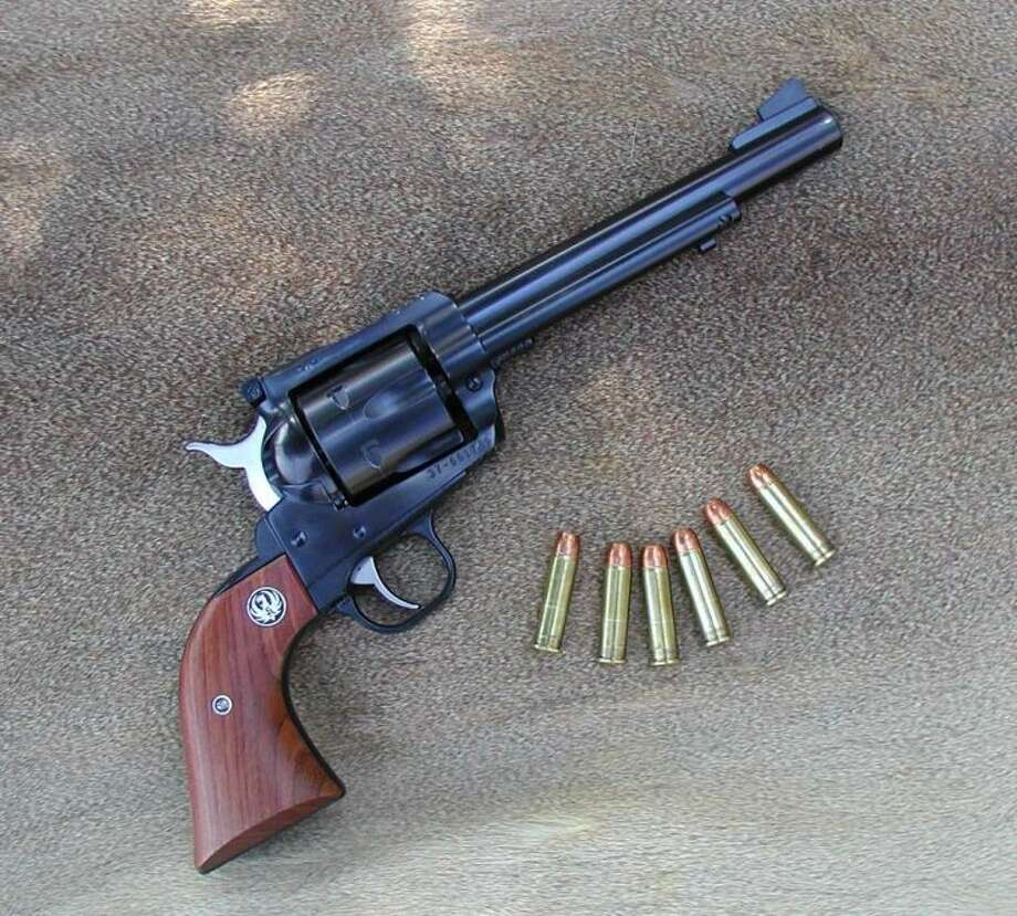 This is a Ruger Super Blackhawk in .357 Magnum, and at the bottom of the deer hunting chain.