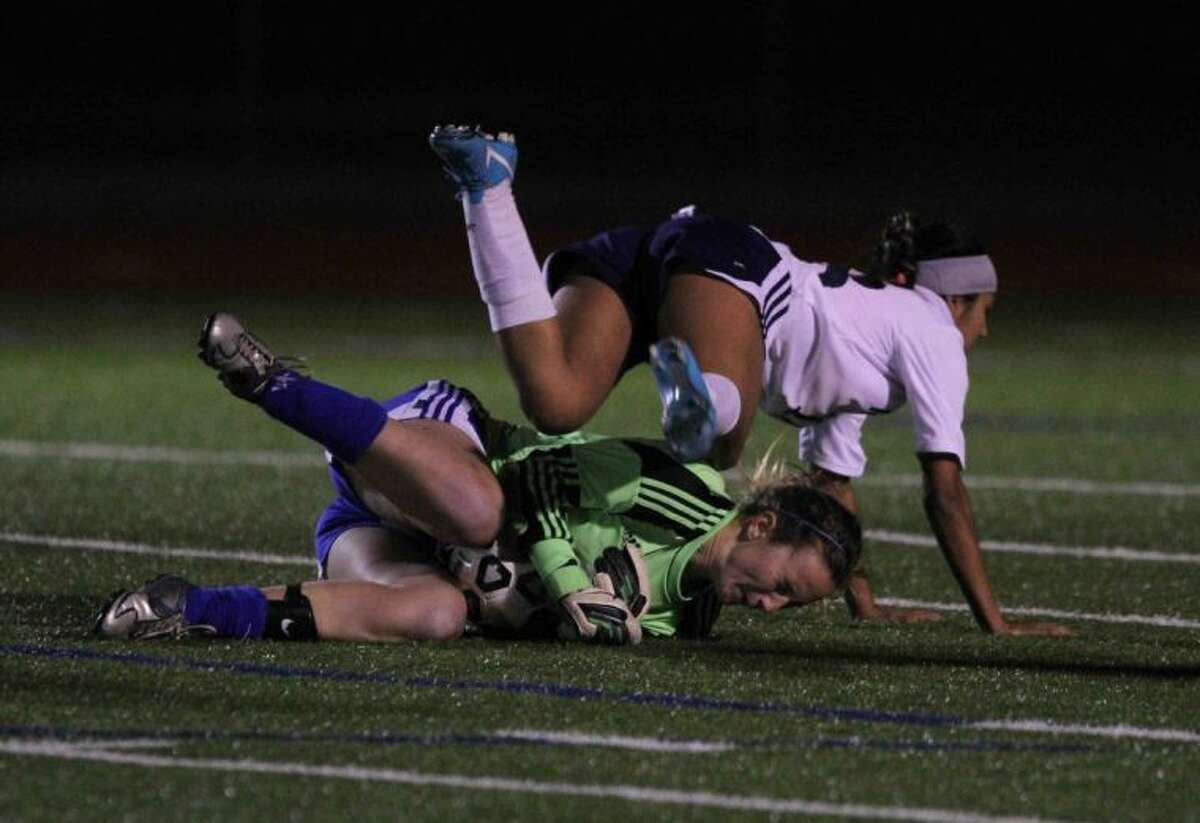 Baytown Sterling's Daisy Mendoza flies over Oak Ridge goalkeeper Katherine Tesno after Tesno made a save Thursday during the I-10 Shootout at Mayde Creek High School.