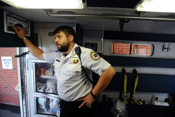 Greenwich EMS paramedic Colin Bassett is on the front lines of New England's war on drugs. Photographed in Greenwich, Conn. on Wednesday, September 7, 2016.