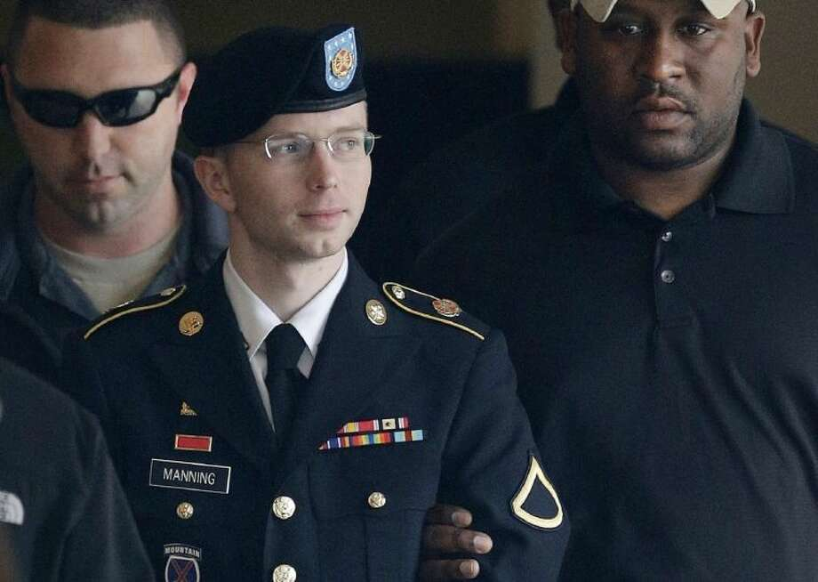 In this Tuesday, Aug. 20, 2013 file photo, Army Pfc. Bradley Manning is escorted to a security vehicle outside a courthouse in Fort Meade, Md., after a hearing in his court martial. Manning plans to live as a woman named Chelsea and wants to begin hormone therapy as soon as possible, the soldier said Thursday, Aug. 22, 2013, a day after he was sentenced to 35 years in prison for sending classified material to WikiLeaks. Photo: Patrick Semansky