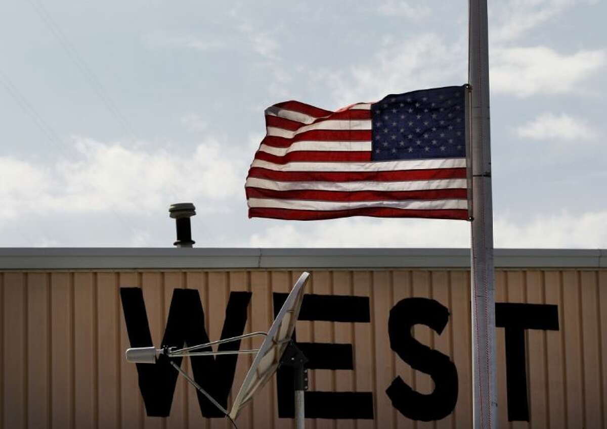 A flag is flown at half staff in West, Texas, near the scene of the fertilizer plant that exploded Wednesday night in West, Texas, April 18, 2013. President Barack Obama has ordered that the U.S. flag at federal buildings and military facilities in Texas be flown at half-staff Thursday, April 25, 2013.