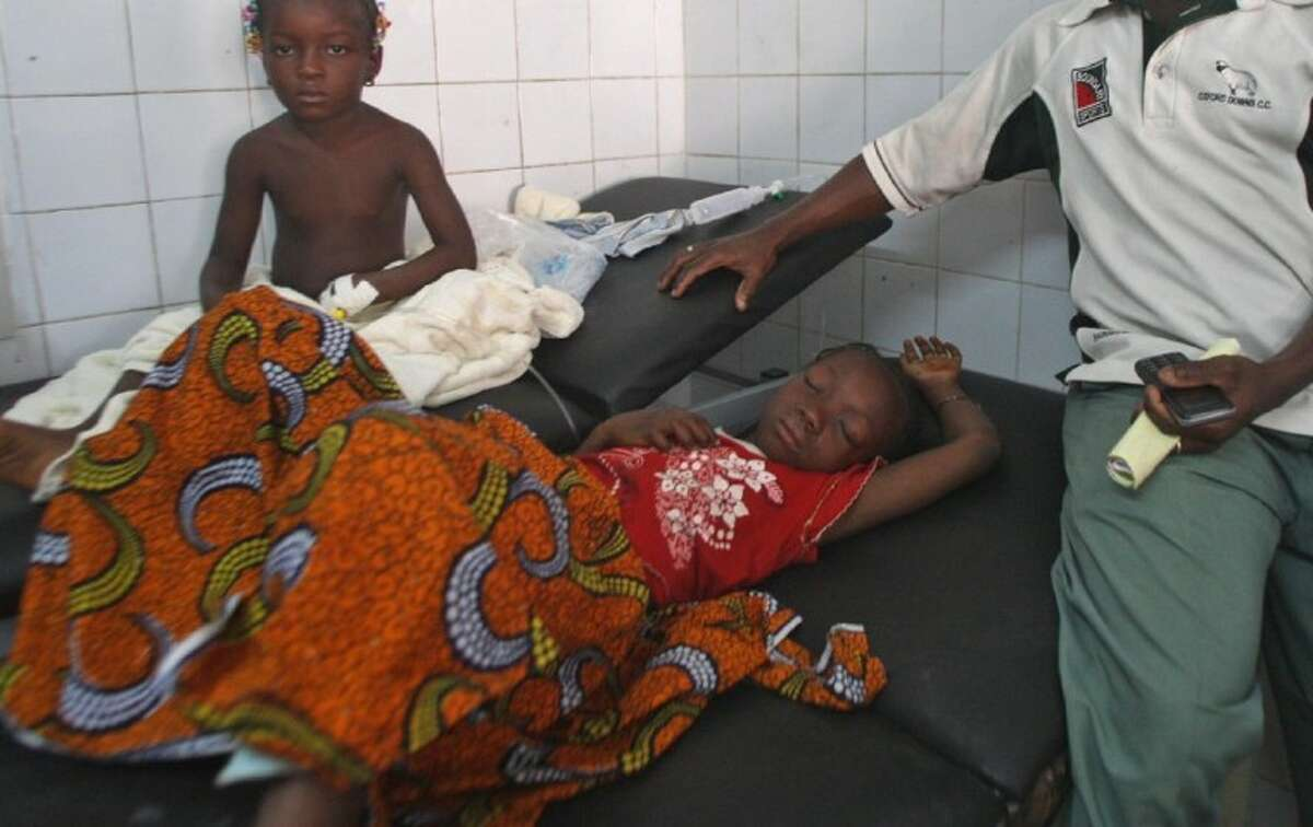 Injured children receive treatment in a hospital after they were involved in a stamped in Abidjan, Ivory Coast, Tuesday.