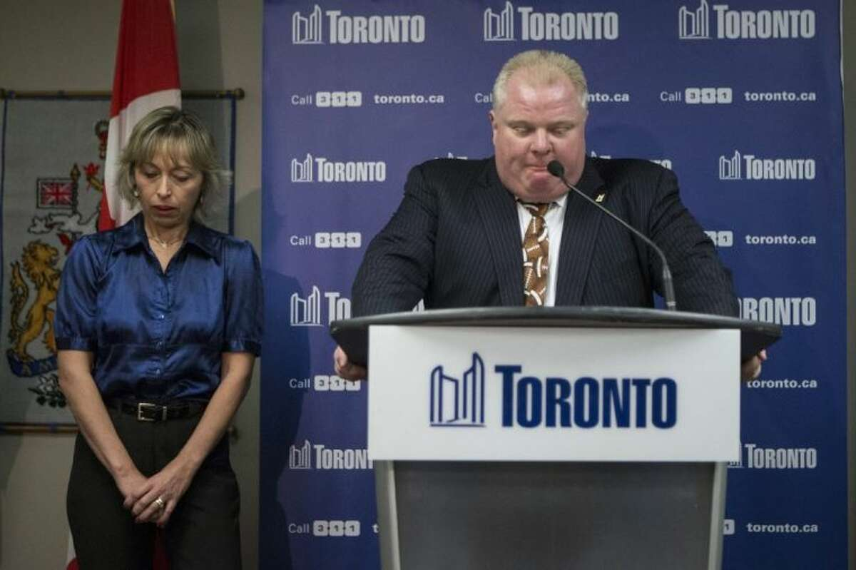 In this Nov. 14 photo, Toronto Mayor Rob Ford stands with his wife, Renata, at a news conference in Toronto. While the spotlight shines brightly on Toronto's embattled and erratic mayor, his wife and two children have remained almost invisible.