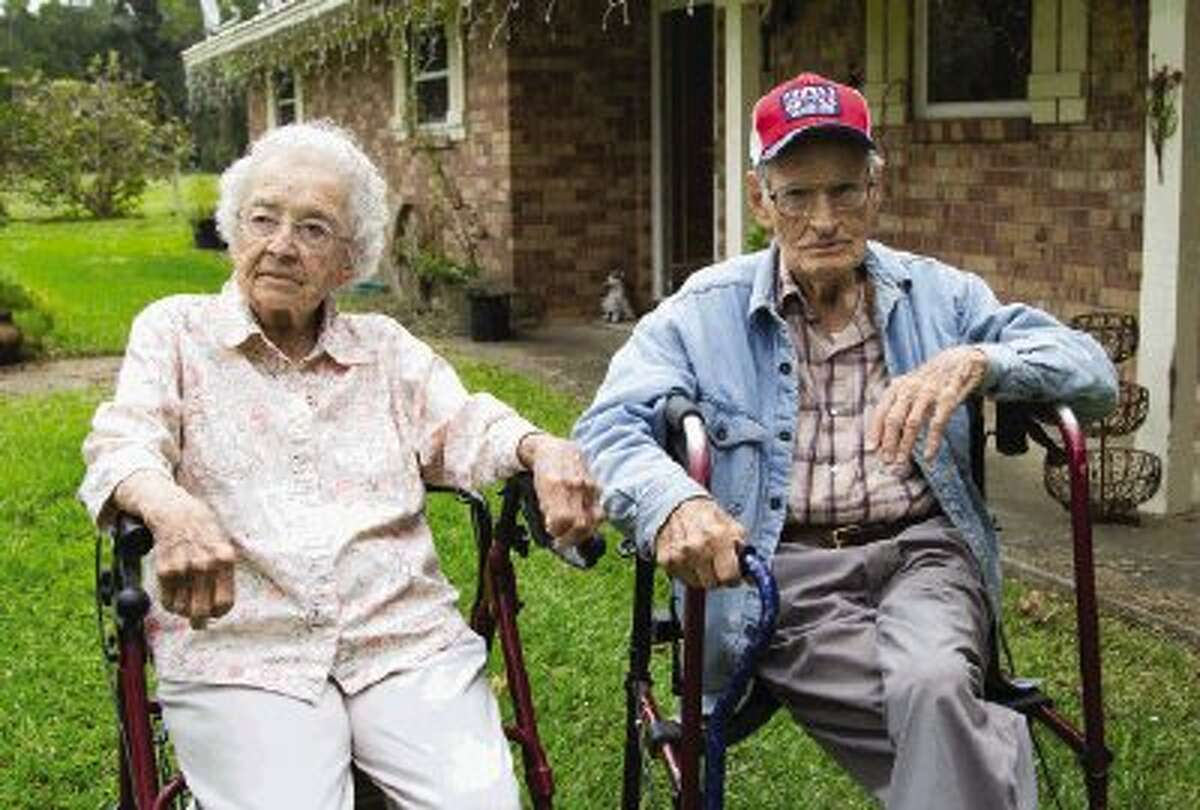 Mary Lou and Ralph Riggs sit in their front yard on a Tuesday afternoon in Willis. The Riggs celebrated their 80th anniversary on Monday, November 4.