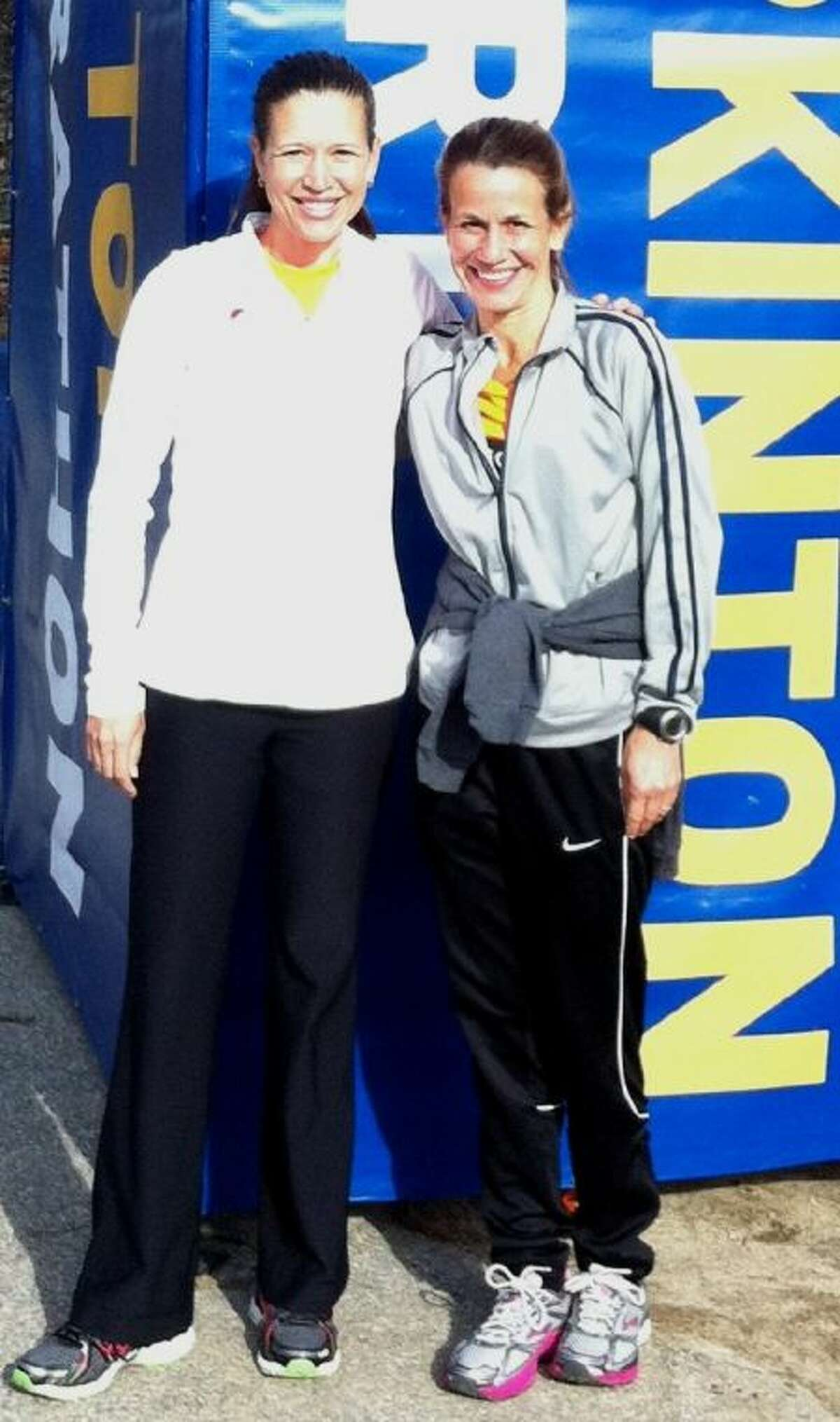 Jessica Menendez, left, and Lisa Hill trained and qualified together to run Monday's Boston Marathon. Both completed the marathon and witnessed the explosions.
