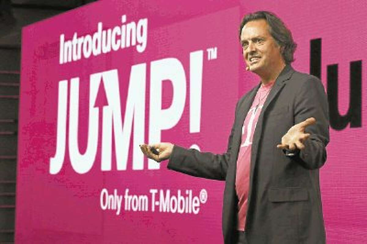 T-Mobile CEO John Legere speaks during news conference Wednesday in New York. T-Mobile says it will let people upgrade phones more quickly for a $10 monthly fee. With the new Jump plan, a customer will be able to get a new phone if the old one malfunctions or gets lost, or even if there's a better phone that comes out. The plan lets customers upgrade up to twice a year. Rivals typically allow upgrades after about two years.
