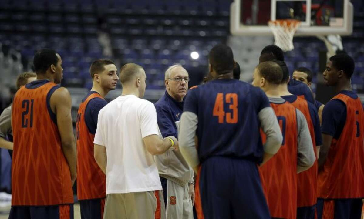 Syracuse coach Jim Boeheim, center, talks with his players at the end of practice Wednesday in Washington. Syracuse plays Indiana on Thursday.