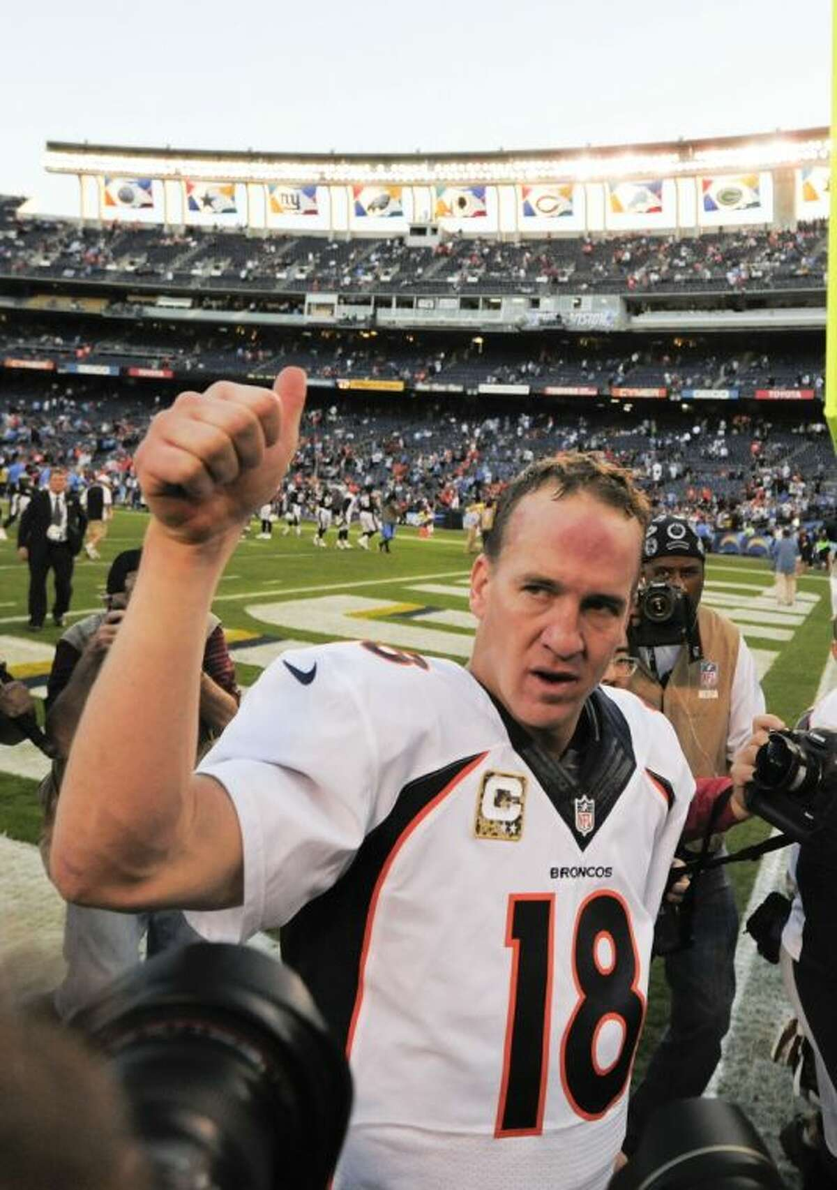 Denver Broncos quarterback Peyton Manning (18) pumps his fist after an NFL football game against the San Diego Chargers Sunday in San Diego. The Broncos won 28-20.