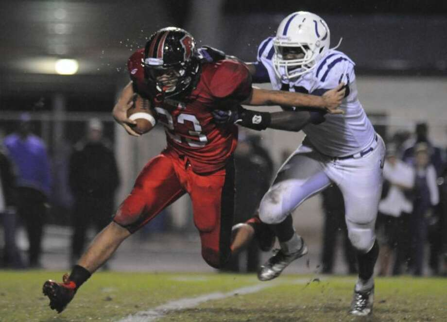 Porter's Blake Rogers tries to fight off a defender against Dayton Friday at Don Ford Stadium. Photo: Keith MacPherson