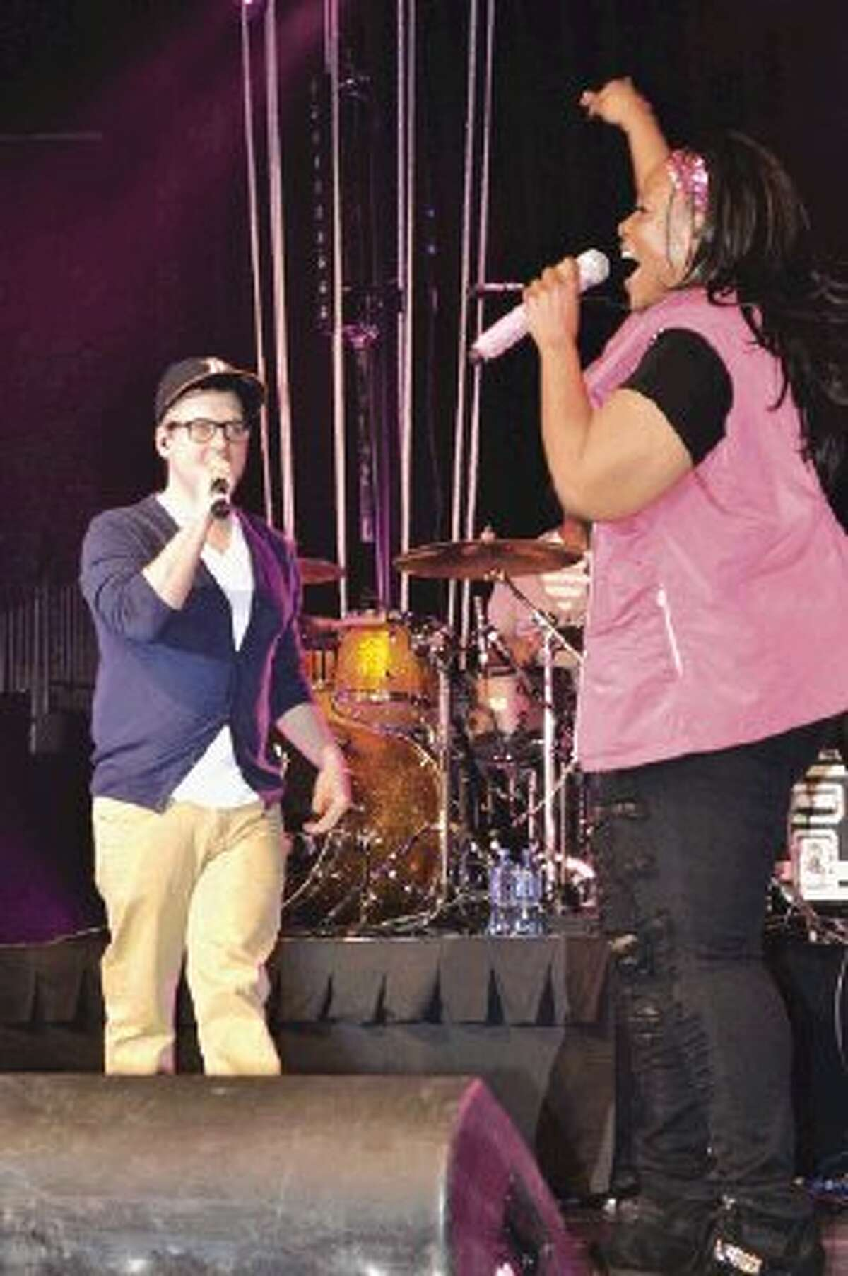 Mandisa introduces James Curlin, a Montgomery resident, during Saturday's concert at the Berry Center. Curlin, who won a KSBJ contest to sing with Mandisa, is the worship and outreach pastor at Fellowship of Montgomery.