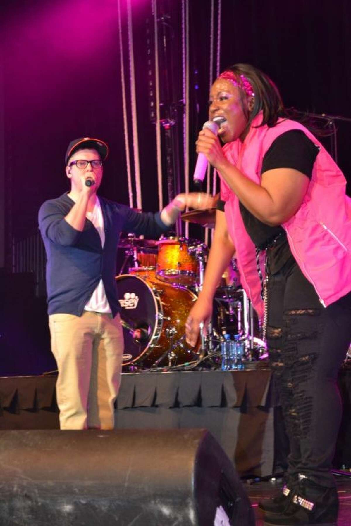 """James Curlin sings """"The Good Morning"""" song on stage with Mandisa Saturday night. Curlin is the worship and outreach pastor at Fellowship of Montgomery."""