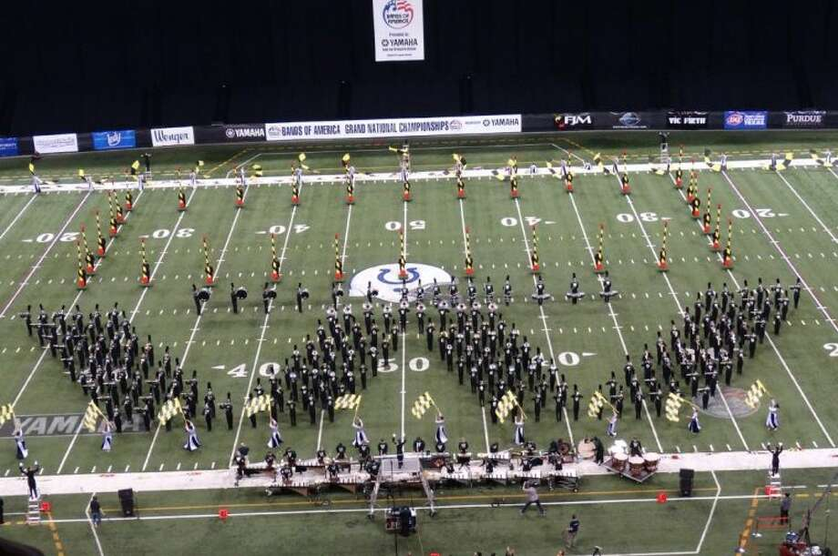 The Woodlands High School marching band performs during finals at the 2013 Bands of America Grand National Championship Nov. 16, held in Indianapolis, Ind. The group took home their first national title and also won awards for Outstanding Music Performance and Outstanding General Effect.