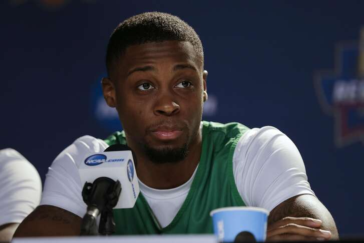 Oregon forward Elgin Cook looks on during a news conference before an upcoming regional finals basketball game in the NCAA Tournament Friday, March 25, 2016, in Anaheim, Calif. Oregon faces Oklahoma in an Elite Eight matchup March 26. (AP Photo/Gregory Bull)