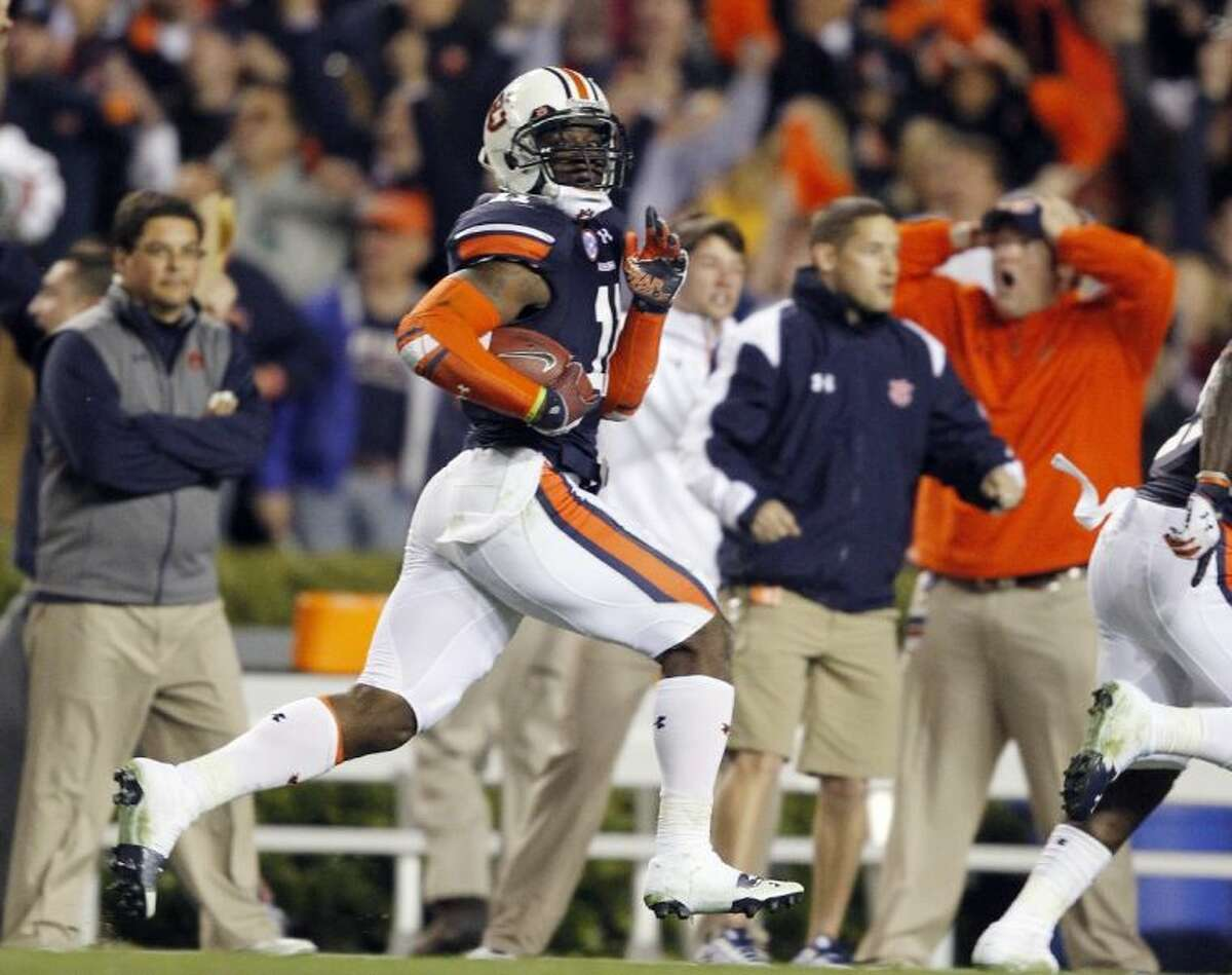 Auburn cornerback Chris Davis returns a field goal attempt 100 yards to beat No. 1-ranked Alabama 34-28 in Auburn, Ala.