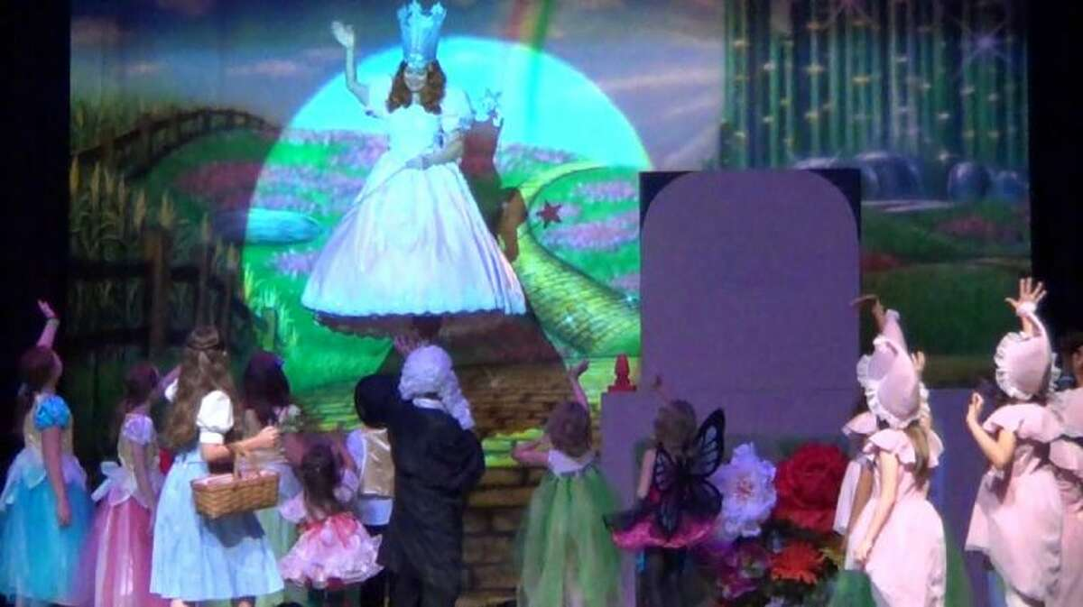 """""""Glinda the Good Witch,"""" played by Elizabeth Garrett Curtin, flys down to greet the munchkins in Stage Right's """"The Wizard of Oz"""" which opens Friday night at the Crighton Theatre. Through ZFX Flying Inc. and a donation from Woodforest Bank, several of the characters will be taking flight."""