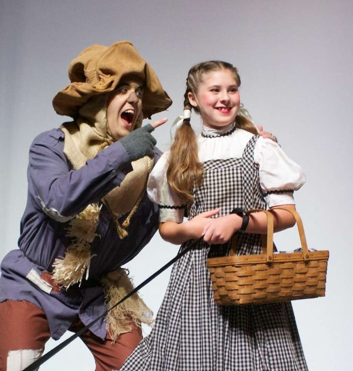Cosette Czarnopis is Dorothy and the Scarecrow is Josh Clark.