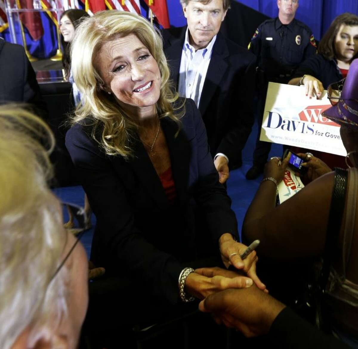 Sen. Wendy Davis, D-Fort Worth, shakes hands with a supporter after a rally Thursday in Haltom City. Davis formally announced her campaign to run for Texas governor.