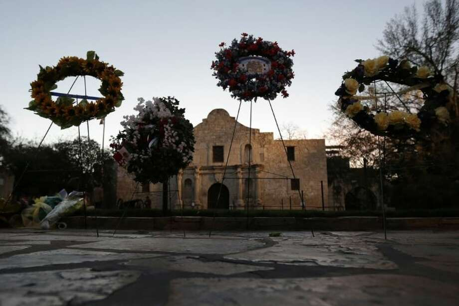 In this March 6 photo, wreaths are seen in front of the Alamo following a a pre-dawn memorial ceremony to remember the 1836 Battle of the Alamo and those who fell on both sides in San Antonio. The Texas General Land Office, which took control of the Alamo in 2011, approved a gun rights rally for today, breaking with tradition that had kept demonstrations off the hallowed ground.