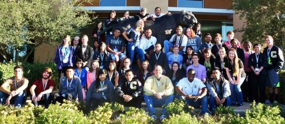 Conroe High School Top Tiger Award Winners for the 2013 Fall Semester pose for a picture recently outside of the campus.