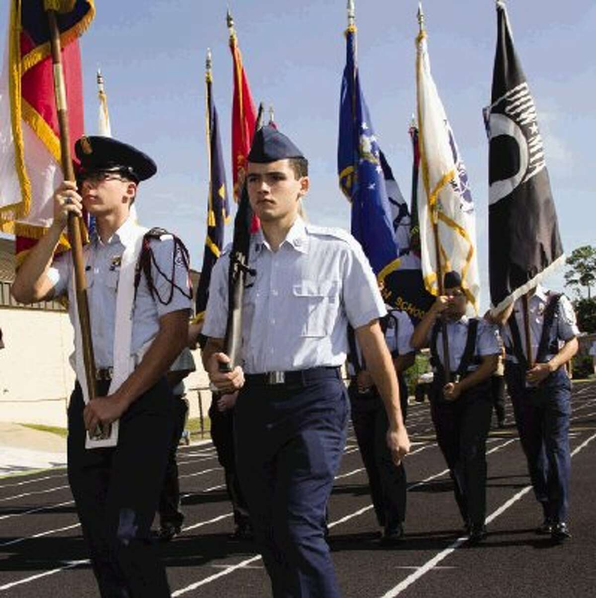 A ROTC group marches during Salute to Our Veterans at Moorhead Stadium. The event was for families, friends, veterans and students to celebrate Veterans Day on Monday in Conroe. Go to HCNPics.com to view and purchase this photo, and others like it.