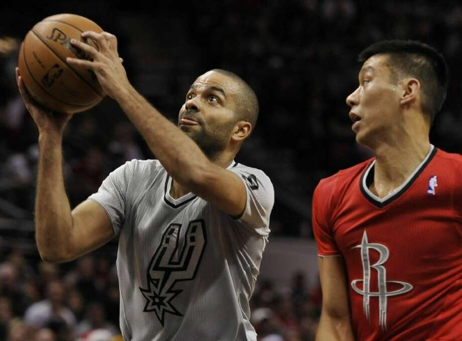 Spurs guard Tony Parker, left, shoots while the Rockets' Jeremy Lin defends. The Rockets won 111-98. Photo: Darren Abate