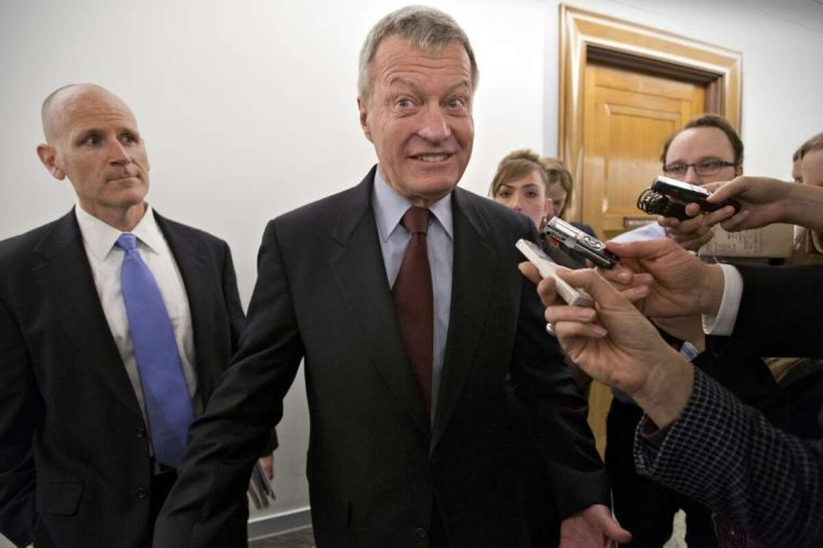 Senate Finance Committee Chairman Sen. Max Baucus, D-Mont. leaves his committee office on Capitol Hill in Washington, Tuesday, saying that he was going to speak to the news media in his home state of Montana before discussing his retirement from the Senate.