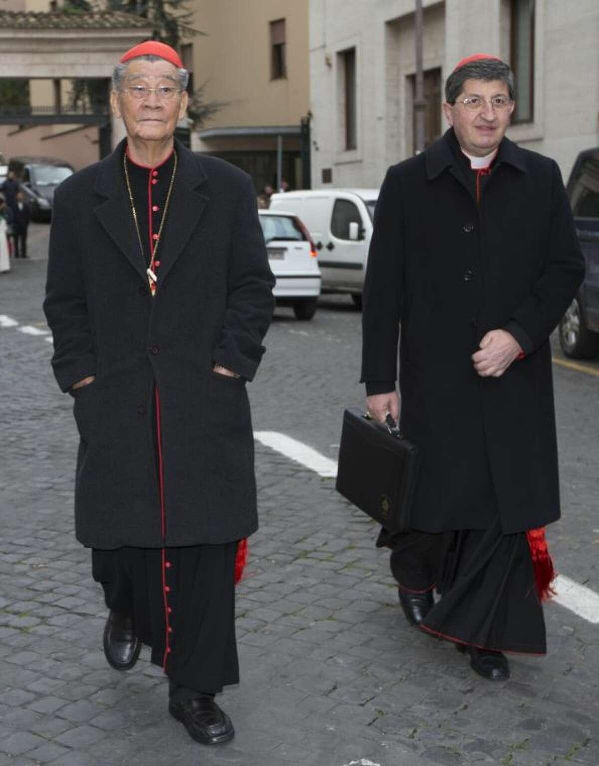 Vietnamese Cardinal Jean-Baptiste Pham Minh Man, left, and cardinal Giuseppe Betori arrive for a meeting at the Vatican Thursday.