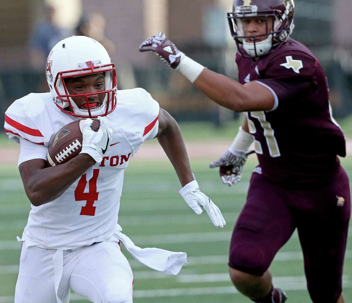 Houston Cougars' D'Eriq King heads to the end zone for a touchdown ahead of Texas State Bobcats defensive back Gavin Graham during first half action Saturday Sept. 24, 2016 at Bobcat Stadium in San Marcos, Tx.