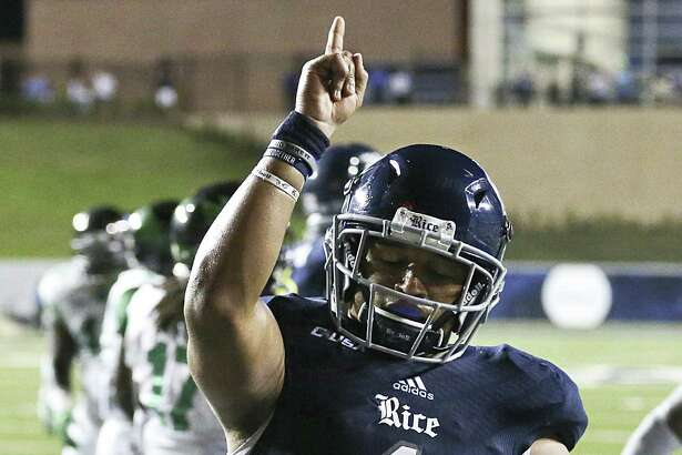 HOUSTON, TX - SEPTEMBER 24: Running back Darik Dillard #1 of the Rice Owls reacts after rushing for a touchdown against the North Texas Mean Green in overtime at Rice Stadium on September 24, 2016 in Houston, Texas.  North Texas Mean Green won 42 to 35 in double over time.