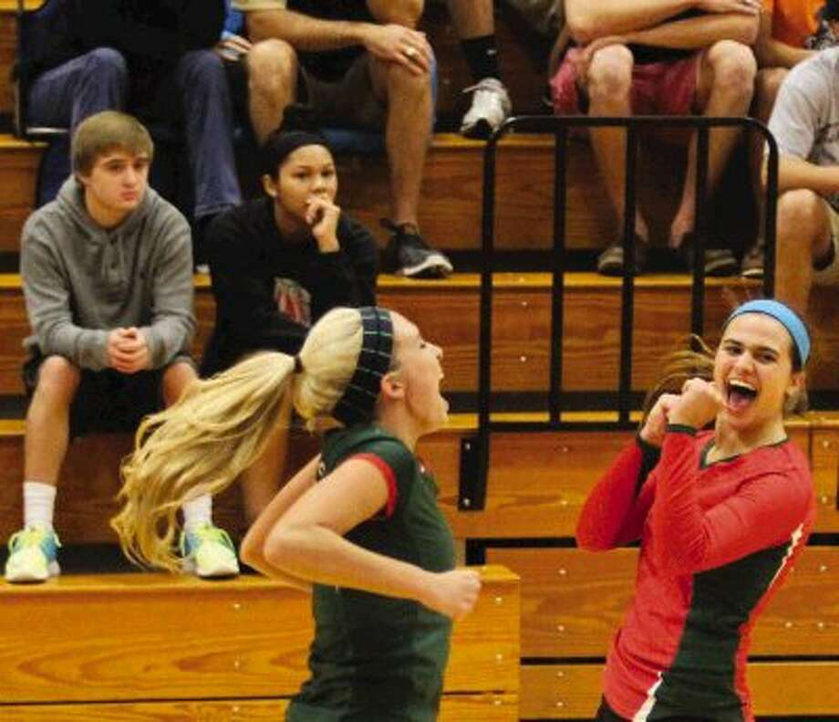The Woodlands' Courtney Quinn (11) and Kelly Quinn (10) celebrate during a playff match against Klein Collins at Tomball High Schooll. The Woodlands won 3 to 0. Go to HCNPics.com to view and purchase this photo, and others like it. Photo: Staff Photo By Ana Ramirez / The Conroe Courier/ The Woodland