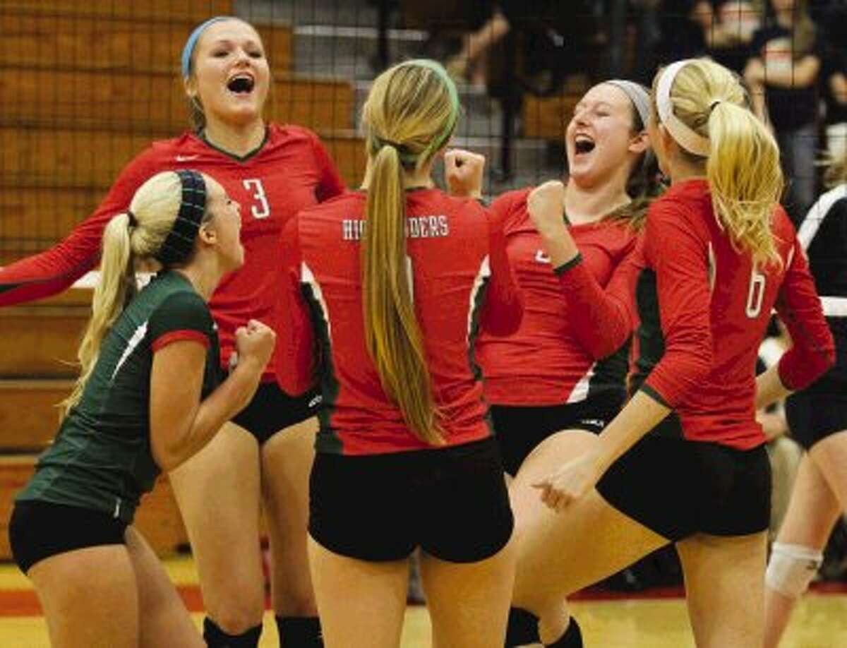 The Woodlands celebrates after scoring a point during a bi-district match against Klein Collins at Tomball High School. Go to HCNPics.com to view and purchase this photo, and others like it.
