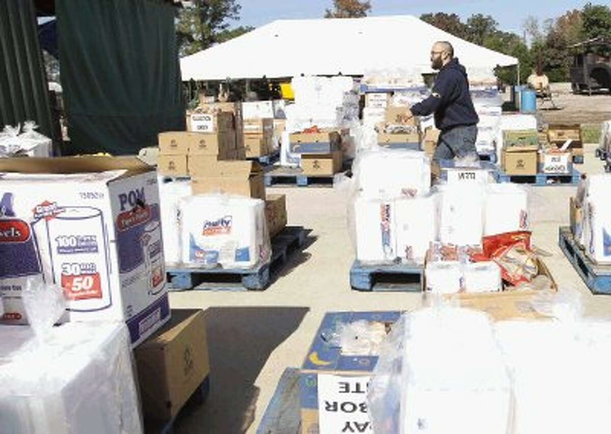 The Ark Church volunteers get supplies ready for today's Thanksgiving meal in Conroe. Organizers estimate 14,000 people will receive a hot meal today at more than 30 locations in Montgomery County.