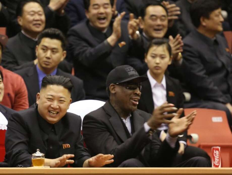 North Korean leader Kim Jong Un, left, and former NBA star Dennis Rodman watch North Korean and U.S. players in an exhibition basketball game at an arena in Pyongyang, North Korea, Thursday, Feb. 28, 2013. Rodman arrived in Pyongyang on Monday with three members of the Harlem Globetrotters basketball team to shoot an episode on North Korea for a new weekly HBO series. Photo: Jason Mojica