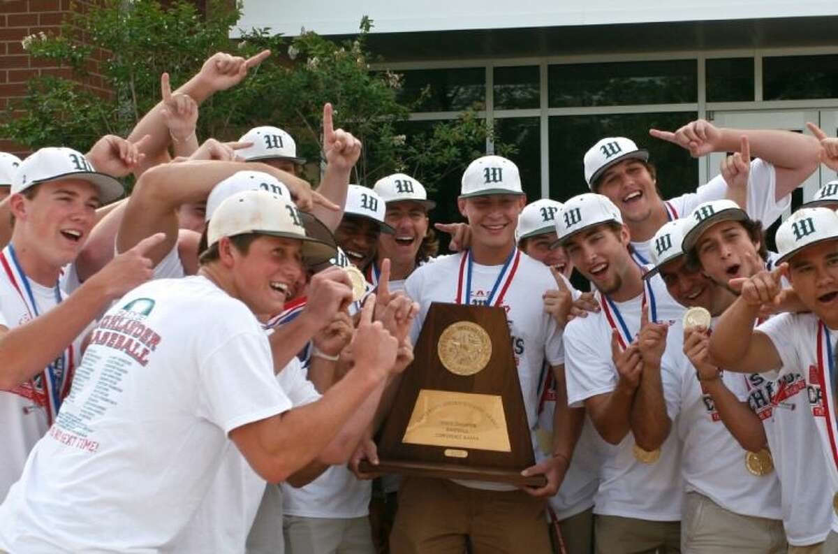 Members of The Woodlands High School baseball team cheer as they are videotaped for a television broadcast before the start of a parade in their honor Tuesday evening. The parade honored the team's 5A state championship win in Round Rock. To view or order this photo and others like it, visit: HCNPics.com.