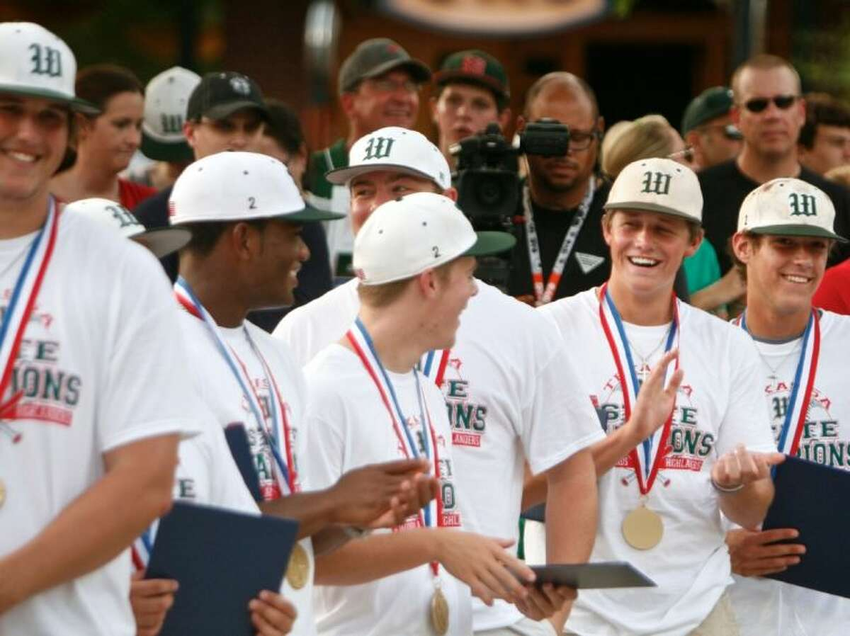 Members of The Woodlands High School baseball team share a laugh as they are introduced following a parade in their honor Tuesday evening. The parade honored the team's state championship win in Round Rock. To view or order this photo and others like it, visit: HCNPics.com.
