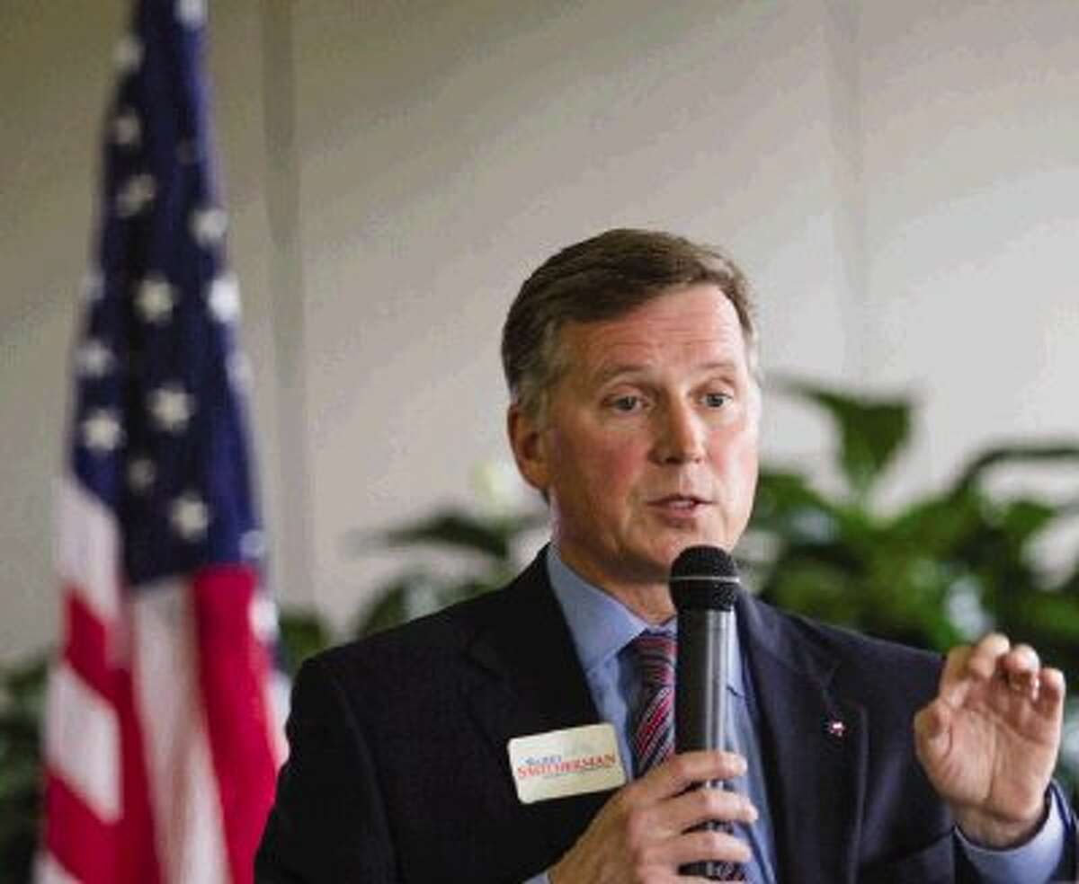 Texas Railroad Commissioner Barry Smitherman, who is a candidate for Texas attorney general, speaks to the North Shore Republican Women on Wednesday at Bentwater Country Club in Montgomery. Smitherman spoke on the Texas oil and gas industry and answered questions and concerns of the NSRW.
