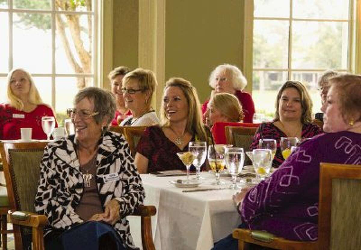 Members of the North Shore Republican Women laugh as Texas Railroad Commissioner Barry Smitherman, who is a candidate for Texas attorney general, makes a joke on Wednesday afternoon at Bentwater Country Club in Montgomery. Smithman answered questions and concerns of the NSRW.