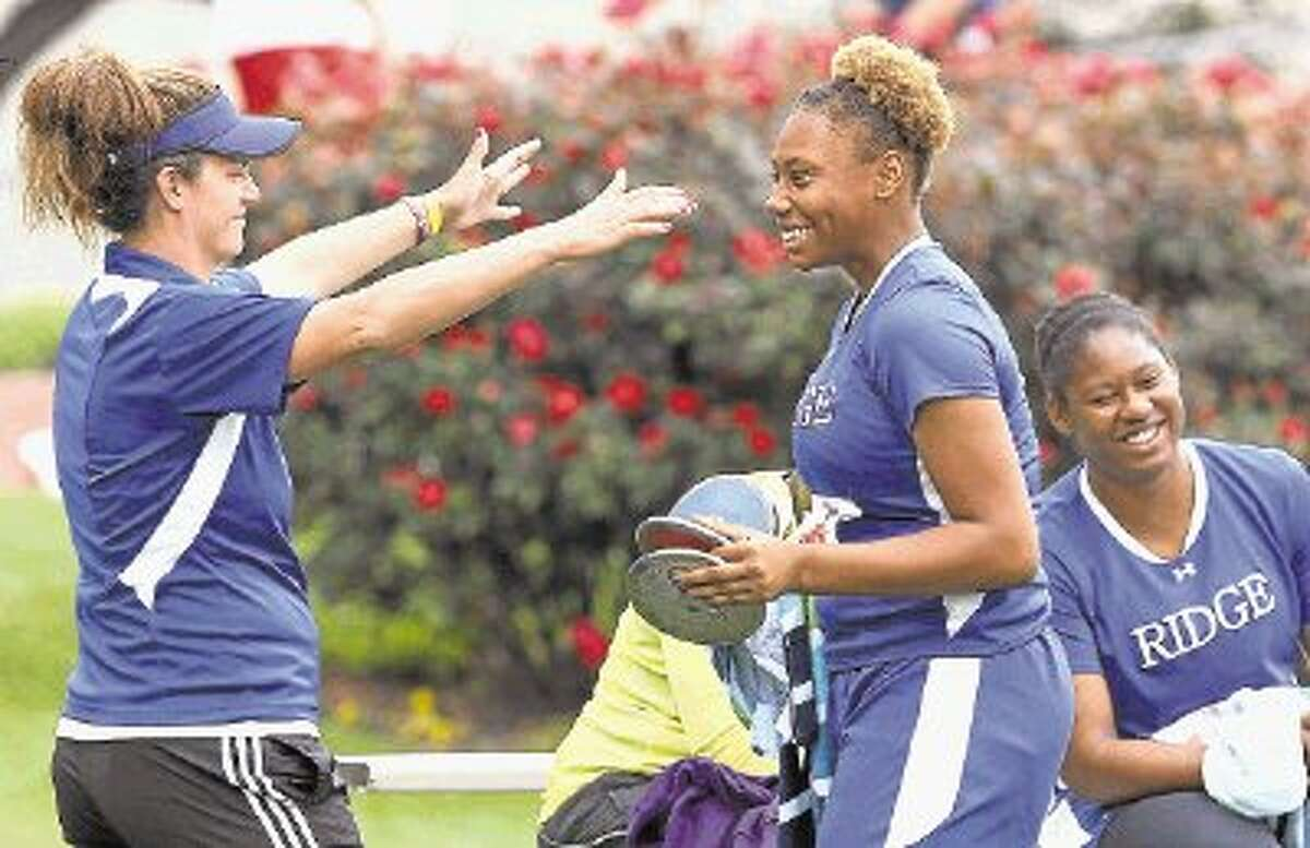 Oak Ridge coach Kristina Dube, left, is taking two qualifiers to the UIL State Track and Field Championships. Sophomore Mia Hicks, middle, will compete in the discus while state meet veteran N'Dia Warren-Jacques returns in the shot put.