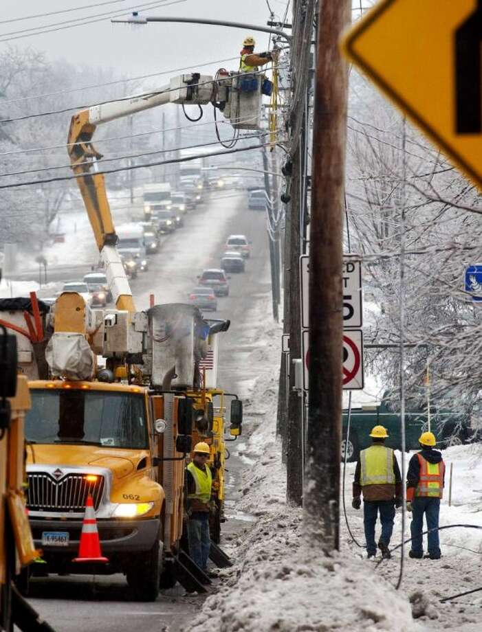 Utility crews respond to a downed power line at the intersection of Dorset Street and Kennedy Drive in South Burlington, Vt., on Monday. Photo: Glenn Russell