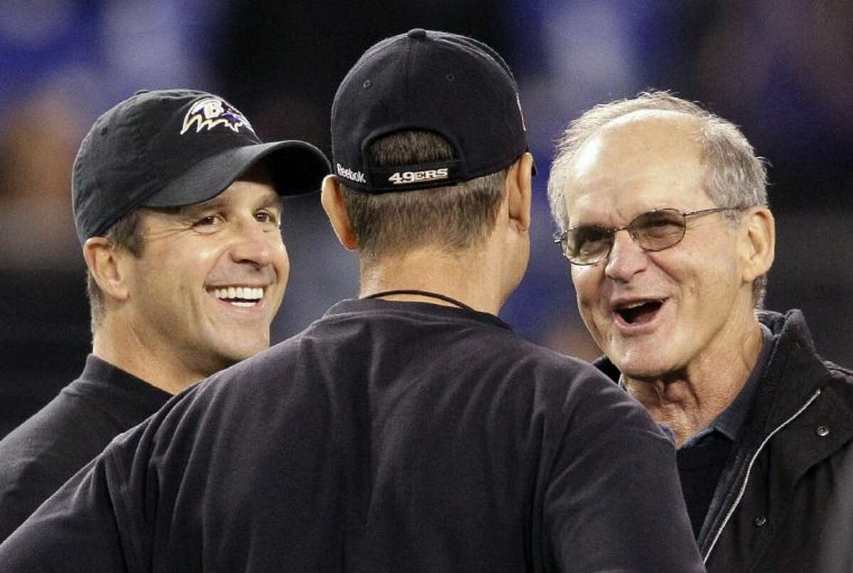 Ravens coach John Harbaugh, left, and his younger brother, Jim, will coach against one another in the Super Bowl. Their father, Jack Harbaugh, right, was a longtime college coach.